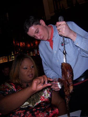 Fogo de Chao Brazilian Steakhouse: My friend enjoying her cut of meat