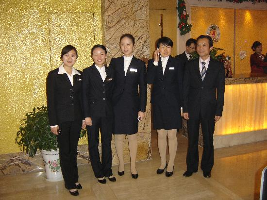 Xiangmei International Hotel: the hotel staff near the reception, in the lobby