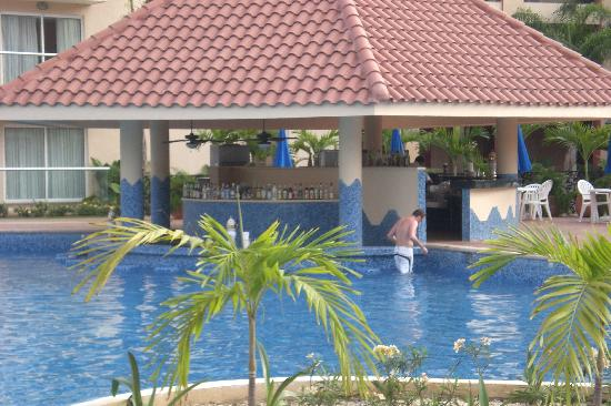 Sitting by pools relaxing picture of sandos playacar - Riviera pool ...