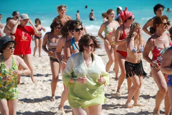 enjoying dance class on the beach