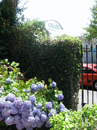 Orari Bed & Breakfast: View of Orari sign, partly showing the gardens.