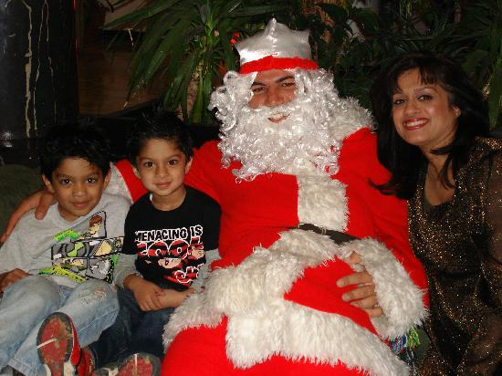 Ramada Liberty Resort Hotel: My wife and boys with 'Papa Noel'