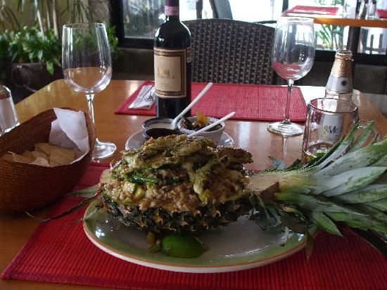 100% Natural: Tilapia over brown rice and vegetables served in a pineapple = $10.00 usd !! AMAZING !