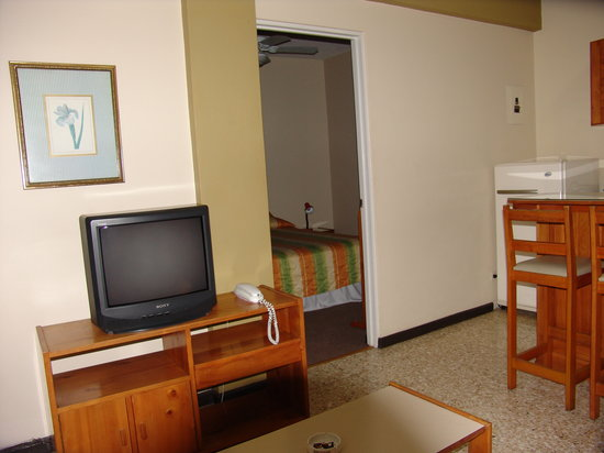 Apartotel  La Perla: My room with TV, Refrigerator, oven and lots of stuff