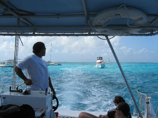 Chip handling the rays - Picture of Stingray Sailing ...