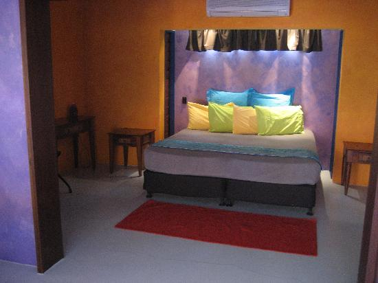 Pink Flamingo: Bed and Bedroom area