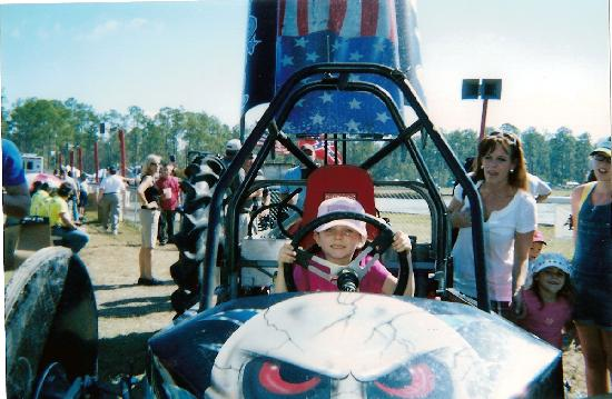 """Swamp Buggy Races: A kid sitting in """"Bada Bing"""" a swamp Buggy that was getting ready to race"""