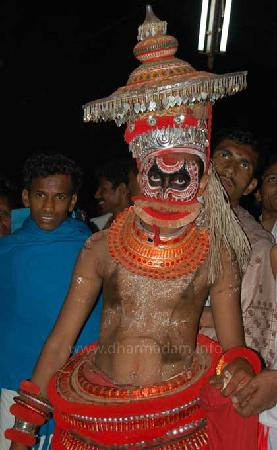 Kannur, India: One of the Theyyam performs at Andalur Kaavu, Dharmadam