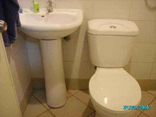 Sampaguita Suites JRG Another View Of The Sink And Toilet Side By