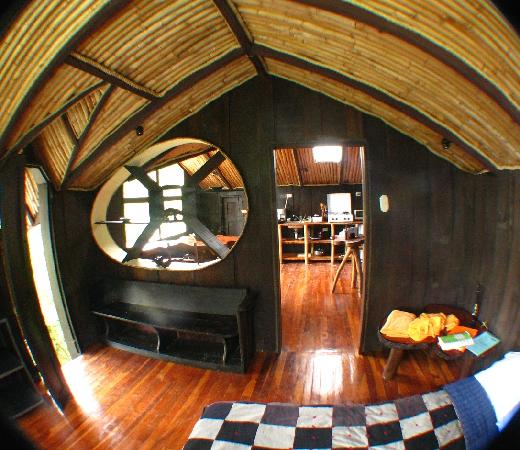 TreeTop House: one upstairs bedroom looking through to kitchen area