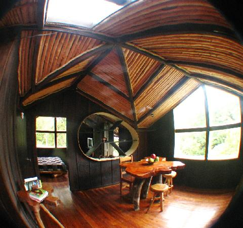 TreeTop House: standing in the other upstairs bedroom door looking to eating area & other bedroom