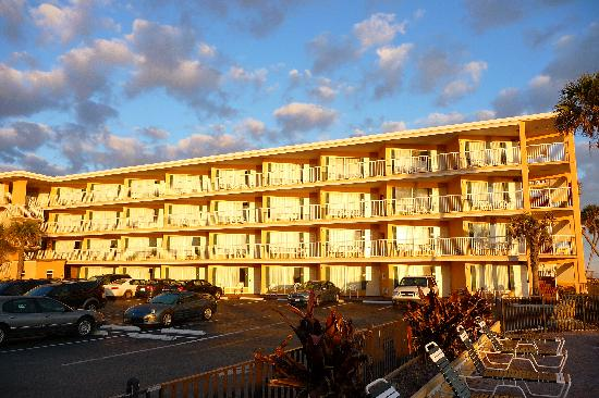 Quality Inn & Suites On The Beach: the building at sunrise