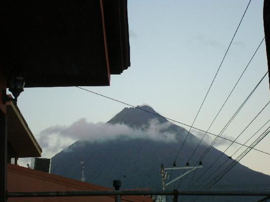 Hotel Arenal Bromelias: View from our room on the street side. Notice the smoke coming from the top.