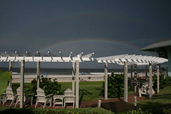 Coconut Palms Beach Resort II: Rainbow over the bungalo sitting area