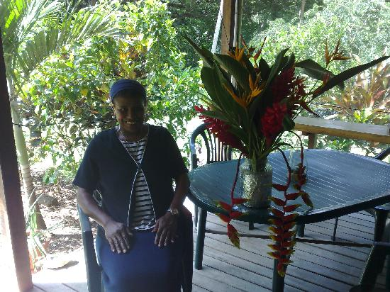 Hans' Place : Ma sitting next to one of her beautiful floral arrangements