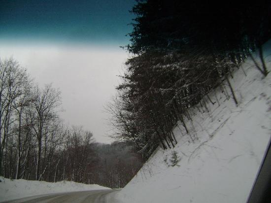 Expedition Station: Dangerous drive out of mountains after snow - notice roads not clear and view is obstructed