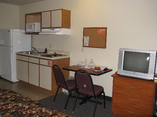 Value Place Brownsville : Kitchen/dining desk/TV/dresser area