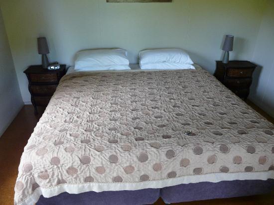 Wharepuke Subtropical Accommodation: King bed in main bedroom