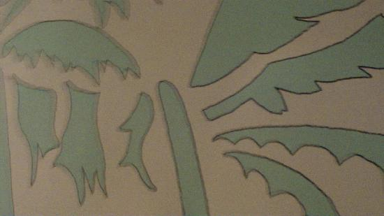 Pension Foidl: A close-up wall view of this palm tree painting in the sauna relaxation area which has recliners
