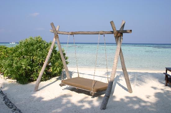 Four Seasons Resort Maldives at Kuda Huraa: swing at reef club