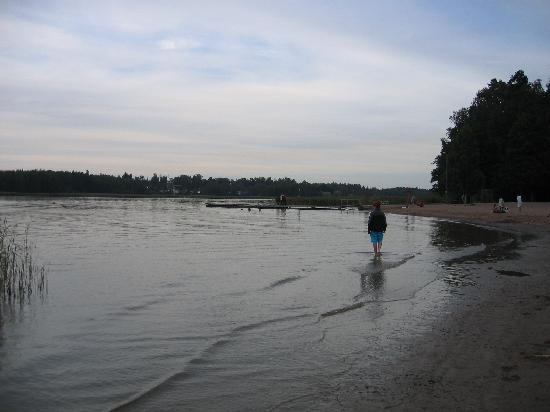 Rastila Log Cottages: The beach and river at Rastila camping.
