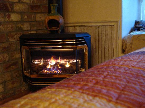 Adobe Village Inn: gas stove fireplace