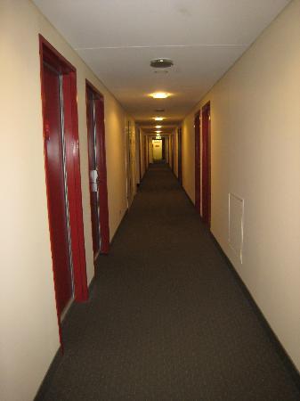 Marketview: Narrow hallway, red doors