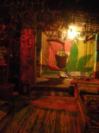 Bob Marley House Hostel: Roof area with hammock, pillows, and coffee tables