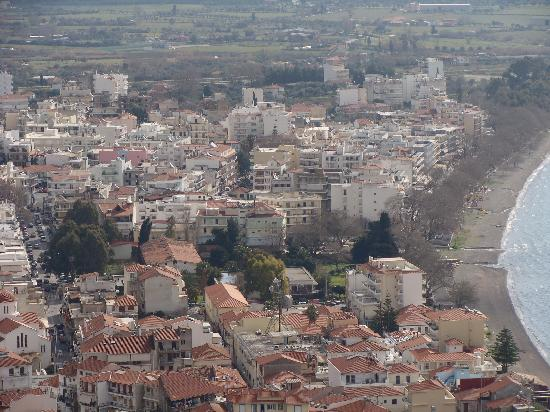 Hotel Akti: Hotel Atki is in pastel shades in the centre of the photo taken from hill-top castle