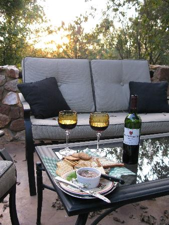 Ibis River Retreat: Snacks and wine at sunset outside cottage