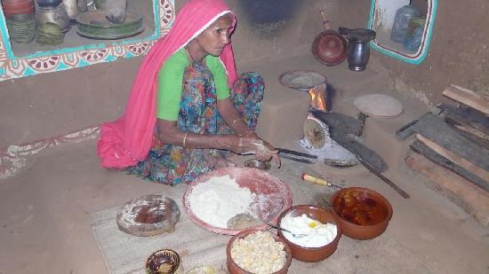 Chokhi Dhani Resort: Chokhi Dhani Village - woman making roti over a fire
