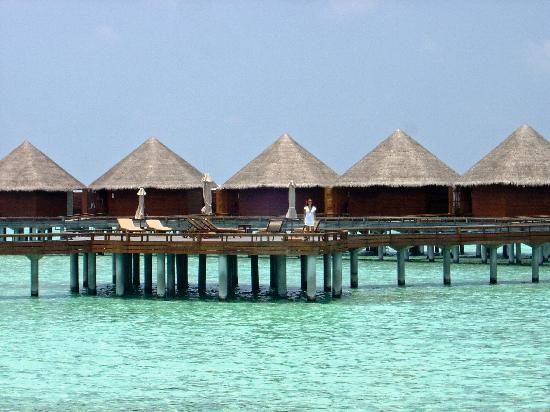 Baros Maldives: Common sundeck surrounded by water villas