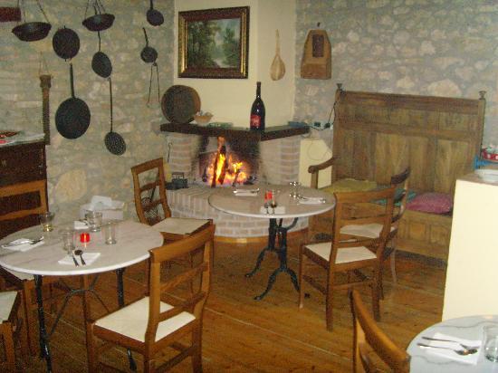 Casale Santa Brigida: Art Monastery Guesthouse: A warm fire in the bar.