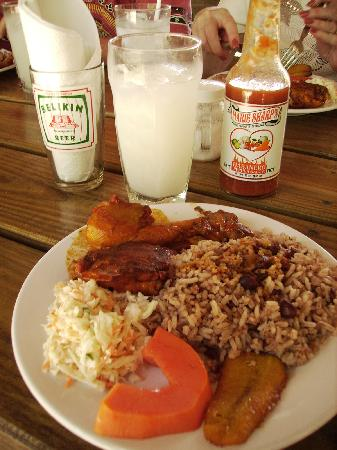 Belize Cruise Excursions: YUMMY lunch. That's the soursop juice & great hot sauce behind the plate.