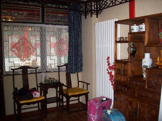 Double Happiness Beijing Courtyard Hotel: Zona de salón para el té