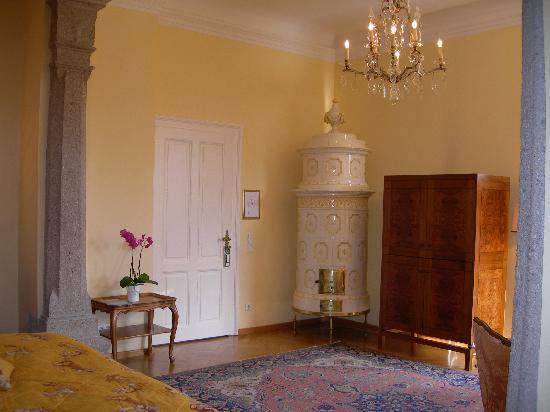 Hotel Schloss Monchstein : Bedroom door, old tile stove in corner