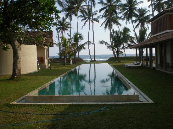The Frangipani Tree by Edwards Collection: Swimming pool looking toward beach