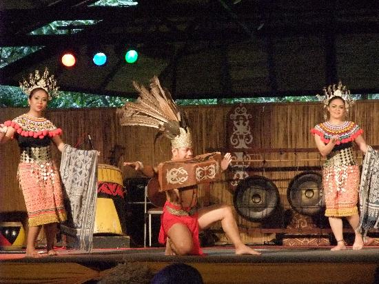 Sarawak Cultural Village: A warrior carrying a heavy item using his mouth!