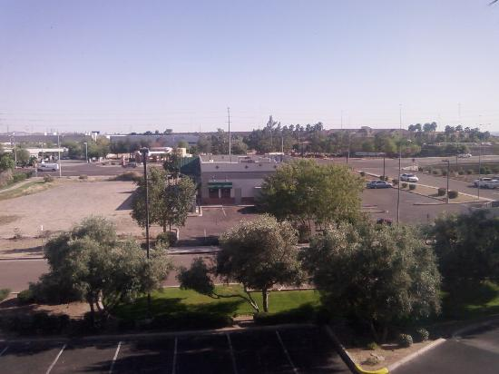 Hampton Inn Phoenix/Chandler: View to south, Denny's and Whataburger visible.