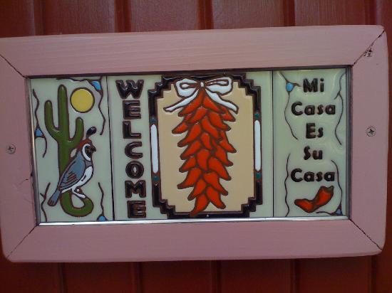 Battiste's Bed, Breakfast & Birds : sign on gate to courtyard