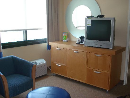 Tv in living room hidden microwave mini fridge for Hide tv in living room
