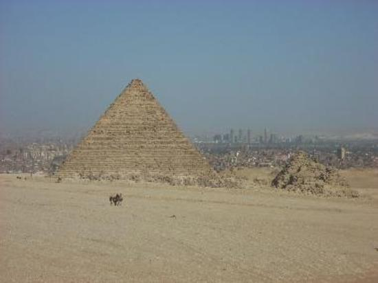 Menkaure's three queens are buried just to the south in the three tiny pyramids next to his.