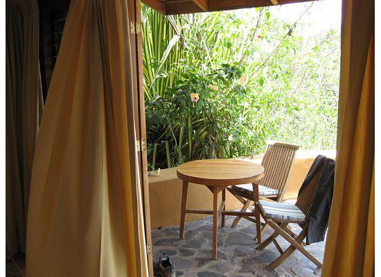 Nature Lodge Finca los Caballos: View from inside the oom of the Balcony/patio on one of the Ocean view rooms