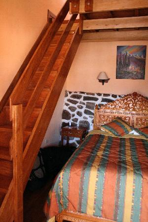 Inside our Room at Amaru Hostal the stairs go up to the bathroom