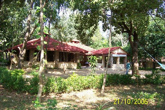 Tiger Trails Resort: Cottages across the lotus pond & lush foliage