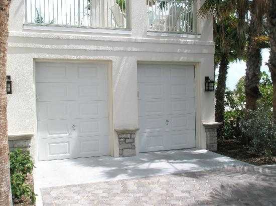 Bedroom patio door villa 1414 picture of grand isle for Golf cart garage door