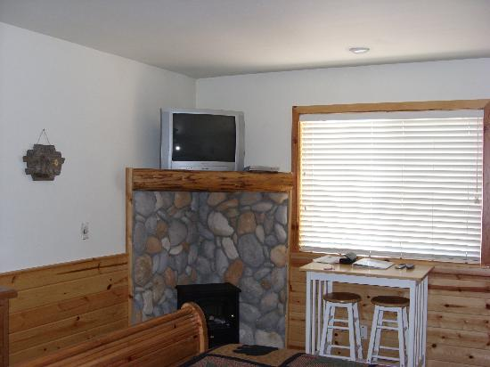 Electric Stove Fireplace And Table Picture Of Lindberg Suites
