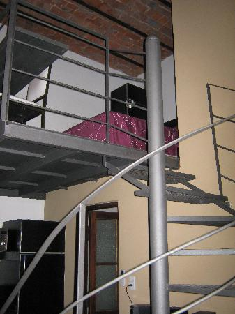 Mundo Bolivar : The spiral staircase in the industrial loft. Our bed was up the top.