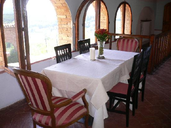 Osteria del Vicario: table in common area outside of rooms