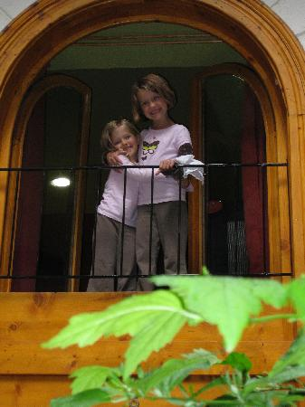 Green Dream Apartment: kids looking out the high window from the main bedroom into the beautiful courtyard